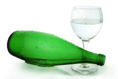 Bottle from green glass. And wineglass  on white Stock Photography