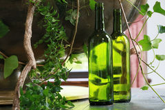Bottle of the green glass. Landscape of green plants and glass bottles Royalty Free Stock Photo