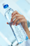 Bottle in hand Royalty Free Stock Image