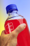Bottle with hand Stock Photos