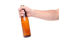 A bottle in a hand. On a white background Stock Photography