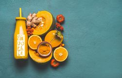 Energetic smoothie, for cold season with orange ingredients: pumpkin, persimmon , orange fruits, ginger and turmeric stock images