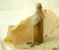 Bottle with healthy tincture and herbal pills. Over old paper background Royalty Free Stock Photos