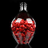 Bottle with hearts Stock Photography
