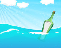 Bottle with help message. Floating in the ocean waves Stock Photo