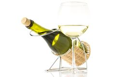 Bottle in holder with glass of wine isolated on white background Stock Photos