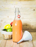Bottle of homemade juice from mixed citrus fruit Stock Image