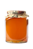 Bottle of honey isolated Stock Photography