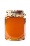 Bottle of honey isolated Stock Photography