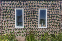 Bottle House, wall and two windows Stock Images