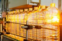 Bottle. Industrial production of plastic pet bottles. Factory line for manufacturing polyethylene bottles. Transparent food packag. Ing stock photo