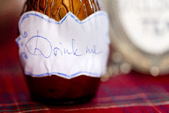 Bottle with inscription Drink me Royalty Free Stock Photo