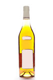 Bottle isolated on white. Bottle of cognac with labels, isolated on white background royalty free stock images