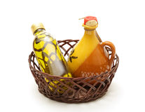 Bottle and jar of virgin olive oil. In basket on white Stock Photo