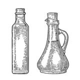 Bottle and Jug glass of liquid with cork stopper. Olive oil. Stock Photos