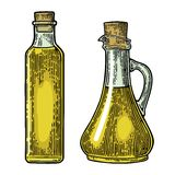 Bottle and Jug glass of liquid with cork stopper. Olive oil. Royalty Free Stock Photo