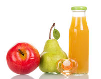 Bottle  juice from fresh fruits and pacifier isolated on white. Royalty Free Stock Photography