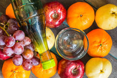 Bottle of juice on  fruits. Royalty Free Stock Photography
