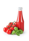 Bottle with ketchup basil and tomatoes isolated on white backgro. Und stock photography