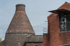 Bottle Kiln behind a factory Stock Photo