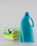 Bottle of laundry detergent. And towels Stock Photography