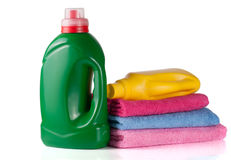 Bottle laundry detergent and conditioner or fabric softener with towels isolated on white background.  Stock Photos