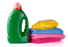 Bottle laundry detergent and conditioner or fabric softener with towels isolated on white background.  Royalty Free Stock Photography