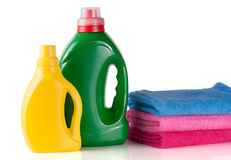 Bottle laundry detergent and conditioner or fabric softener with towels isolated on white background.  Stock Photography