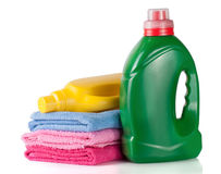 Bottle laundry detergent and conditioner or fabric softener with towels isolated on white background.  Royalty Free Stock Image