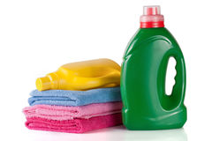 Bottle laundry detergent and conditioner or fabric softener with towels isolated on white background.  Stock Photo