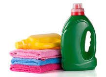Bottle laundry detergent and conditioner or fabric softener with towels isolated on white background.  Royalty Free Stock Photo