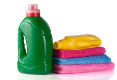 Bottle laundry detergent and conditioner or fabric softener with towels  on white background.  Stock Photos