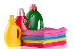 Bottle laundry detergent and conditioner with towels isolated on white background Stock Photography