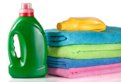 Bottle laundry detergent and conditioner with towels isolated on white background Royalty Free Stock Photography
