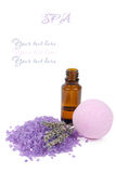 Bottle of lavender essential oil and spa salt bomb. Isolated on white background with the sample text Royalty Free Stock Photo