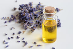 A bottle of lavender essential oil on a white background Stock Image