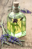 Bottle of lavender oil with fresh flowers. healthy herbs Royalty Free Stock Photos