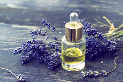Bottle of lavender oil and lavender flowers Royalty Free Stock Images