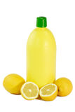 A Bottle Lemon concentrate. And fresh lemon on bright background Stock Photo