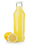 Bottle of lemon juice and fresh lemons Stock Photos