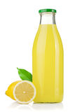 Bottle of lemon juice and fresh lemons Royalty Free Stock Photography