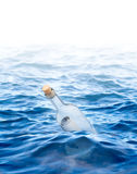 Bottle with a letter in the sea Royalty Free Stock Photography