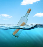 Bottle with a letter from the wreck Royalty Free Stock Images