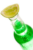 Bottle with lime Royalty Free Stock Image