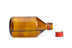 Bottle with liquid and cap near Royalty Free Stock Photos