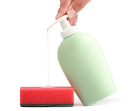 Bottle of liquid soap and cleaning sponge Royalty Free Stock Image