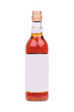 Bottle of liquor. With blank label isolated on white Royalty Free Stock Photos