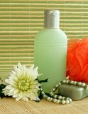 Bottle of lotion and flower. Stock Photography