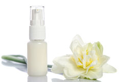 Bottle with  lotion and flowers Stock Photo