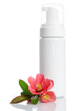 Bottle with  lotion and flowers Royalty Free Stock Image
